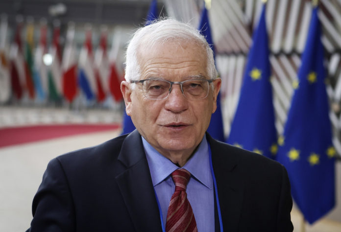European Union foreign policy chief Josep Borrell speaks to the media as he arrives for a meeting of EU foreign ministers at the European Council building in Brussels, Monday, March 22, 2021. (Aris Oikonomou, Pool via AP)
